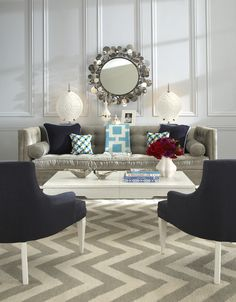 Love the chevron gray area rug and the wall!