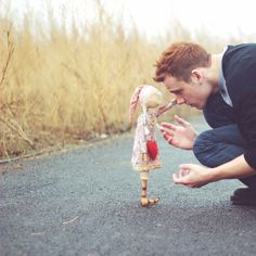 I love the atmosphere of this photo. That and the choice of subjects; ordinarily you wouldn't see a guy in this kind of picture. It's great to see a picture of a fellow guy with a doll that isn't supposed to be a joke.