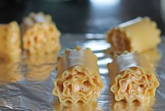 These Buffalo Chicken Lasagna Roll-Ups are like Buffalo wings, mac and cheese and lasagna, all rolled into one! Just 305 calories or 8PP on Weight Watchers! www.emilybites.com #healthy