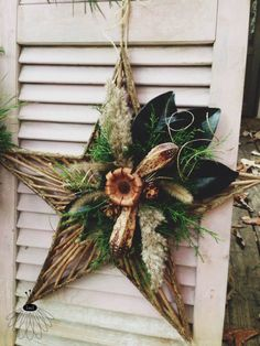 Holiday wreath ideas. Star on old house shutter. Be creative & paint shutter etc and decorate to your taste / style