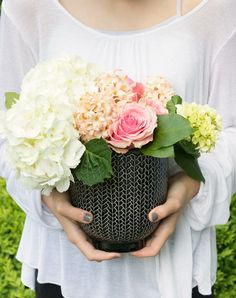 A small bouquet of flowers in a pot that can be reused is the perfect hostess gift idea!