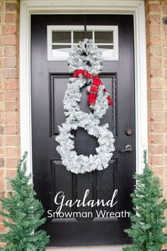 Turn a Christmas garland into a Snowman Wreath. Cheap Christmas wreath idea! Or Winter Wreath. MichaelsMakers Craftaholics Anonymous
