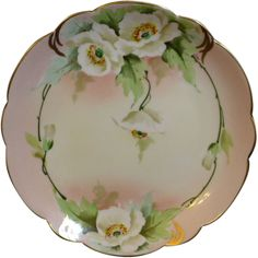Beautiful Pickard china scalloped edge plate with naturalistic white flowers with green leaves. Signed by Harry E Tolley and marked on the back with