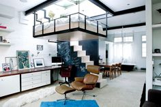 A full apartment within a small living space. The use of space here and the layout of the home are savvy and distinctive. There may be a lot going on within the space, but it doesn't seem overcrowded and there is still space to walk around freely.