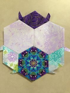 "Katja Marek's The New Hexagon - Millefiore Quilt-Along: Rosette 1: ""block 1 - Marie"" -- completed by Tracy Pierceall, 1/21/2015"