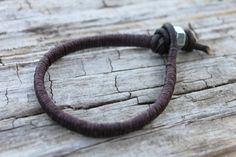 http://www.etsy.com/listing/97651808/single-mens-leathercord-wrap-bracelet