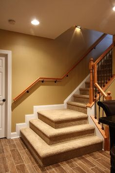 Basement Stairs traditional staircase plus wood-look flooring Basement Steps, Basement Flooring Options, Basement Remodel Diy, Modern Basement, Basement Makeover, Basement Bedrooms, Basement Renovations, Home Remodeling, Basement Bathroom