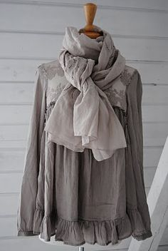 I just love the light sheer blouse with a scarf in the same color pallet.  Really beautiful.
