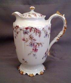 Offered is this very nice Haviland Limoges Chocolate Pot in Schleiger 659. The pattern features transfers of pink and blue flowers including carnations. It employs the Star Blank with brushed gold on