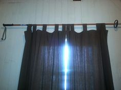 Repurposed an old ski pole for a curtain rod.