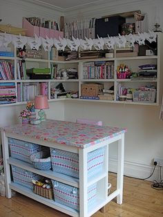 Nice work table for sewing room. Storage on one side but open on the other so it's comfortable to sit at too. For my someday-sewing-room