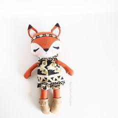 """You asked for it...now it's here! The dress-up fox! Meet Farah the Fox, she is a 17"""" dress-up doll wearing a fabulous black and gold romper, moccs and headband. Her fur is a burnt orange fabric with little gold polka dots. Love it so much! She's listed in the shop."""