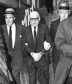"Henry Tameleo, a former underboss of the Patriarca crime family, is escorted by FBI agent H. Paul Rico, left, and his partner, Dennis Condon, right. Rico recruited Stephen Flemmi as an FBI informant in the 1960s and was later indicted for helping James ""Whitey"" Bulger, Flemmi and others in their Winter Hill gang assassinate the owner of World Jai Alai. Tameleo was one of four men Rico framed in the 1960s; he died in prison before the four men were exonerated"