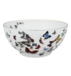 Christian Lacroix Butterfly Parade china collection with realistic graphic butterflies. Scalloped edging with gold details. Available on Alchemy Fine Home| www.alchemyfinehome.com