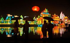 Visitors admire illuminated lanterns as part of Lunar New Year celebrations in central China's Anhui province