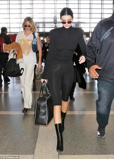 The details: The daughter of Kris Jenner accessorized with some black tint sunglasses and ...