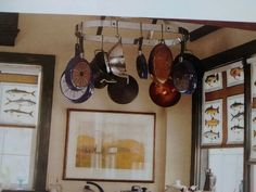 Noticing that I like pot racks.  Would free up under cabinet space beside stove.