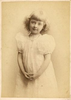 A photograph of Iva in a simple white dress, taken between 1890 and 1892.