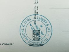 intersting coat of arms on the back of a postcard