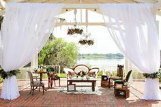 Decor for a lakeside sitting area  (Flowers by Lee Forrest Design, photo by: Tab McCausland Photography)