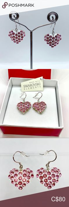 Pink Swarovski crystal heart earrings Fall in love with these pretty pink Swarovski® crystal heart dangle earrings. Hand crafted on a heart shaped transparent lucite, while embellished with baby pink Swarovski® crystal stones.   These elegant earrings are made with 925 sterling silver hook backings, lead and nickle free and are perfect for sensitive ears. Lightweight, easy to wear, comfortable, and look amazing when worn.  Makes a perfect gift idea. Luxury gift box and certificate of…