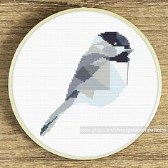 Tittle: Geometric chickadee. Joint project with villavera.etsy.com  This PDF counted cross stitch pattern available for instant download.  Skill level: Beginner+.  Floss: DMC (9 colors)  SIZE: Design Area: 80h x 70w stitches. Area of embroidered image 5.8 x 5.0 inches if you use 14-count Aida fabric You can frame this embroidery in 8x10 inches frame, or 8x8 inches frame, or 8 inches hoop.  This PDF pattern include: • image of finished design • stitch diagram (in color) with DMC stranded…