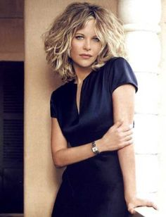 I love Meg Ryan's hair. Its a good cut because it's not going triangle. It is important to find a hairdresser that understands how to cut curly hair.