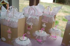 Some mason jars, brown paper bags and lots of pink tulle, hot glue, and ribbon.....and Ta-Da! Ballerina Party thank you gifts & take home sippy cups!