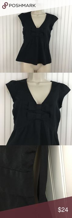 "Anthropologie Odille black bow front Blouse Super cute Anthropologie Odille black Blouse. This top has a V- neckline with two bows in the front.  Cap sleeves. Hidden side zipper.  In good condition. No rips stains or holes. Approximate measurements flat across Chest: 16"" waist: 14"" Length: 21"" Anthropologie Tops Blouses"