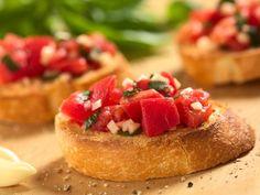 A 5-star recipe for Buca Di Beppo Bruschetta made with basil, salt, olive oil, black pepper, garlic, red onions, Roma tomatoes, bread, garlic