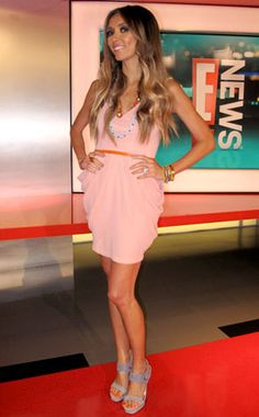 Giuliana Rancic she has been through so much but she followed her dreams.. i would love to work on e news someday