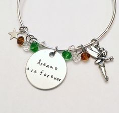 Dreams Are Forever Tinkerbell Peter Pan Disney Inspired Neverland Stamped Adjustable Bangle Charm Bracelet #disney #disneyland #movies #tinkerbell #neverland #peterpan #secondstartotheright #stamped #adjustablebangle #charmbracelet