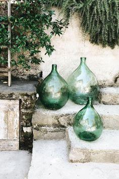 Green glass bottles for the garden – rustic home exterior