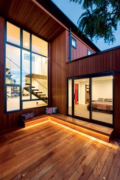 A Mondrian-style window overlooks the west-facing deck, breaking up the verticality of the cedar cladding and admitting an abundance of natural light into the home.