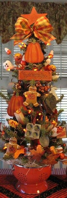 Elegant Halloween Tree with a baking theme.  Unable to locate original post  a8b4395192a243f02bc7960ff12bb3c5.jpg (272×800)