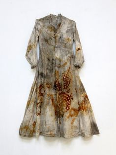 Rusted and naturally stained vintage garment by Susan Lenz