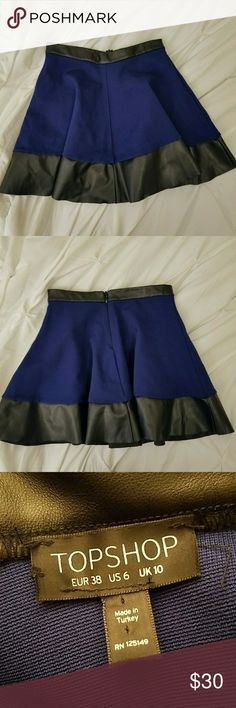 "Topshop Navy and Faux Leather Skirt Cute navy blue skirt with faux leather detail,  stretchy, zipper closure on back.  Like new condition Size 6 Length 16"" waist 14"" Topshop Skirts Mini"