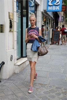 street style: graphic tee, lace skirt, red chucks