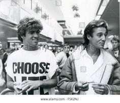 WHAM ! UK pop duo of George Michael and Andrew Ridgeley at London Airport in 1984