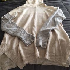 Ann Taylor Medium Petite Cashmere Sweater Ann Taylor two colored cream and grey extra long turtle neck wore maybe three times! Slits on each side beautiful to wear with anything! Ann Taylor Sweaters Cowl & Turtlenecks