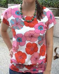 Bright Blossom Top - $13.00. You can style it with some nice skinny jeans or a cute pencil skirt.