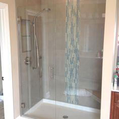 Vertical tile accent, adjustable shower head w glass door