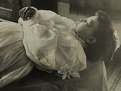 A beautiful post mortem picture of a deceased child. I think late 19th or early 20th century.