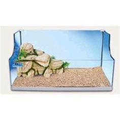 $86 Elegance 60. Tartarughiera Elegance 60 con isola in resina  (vano filtro completo di pompa).  Dimensioni: 61x32x30,5h cm