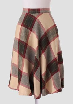 Create a variety of vintage-inspired ensembles with this wool-blend midi skirt featuring a bold plaid print in hues of beige, red, and green. Perfected with a banded waist and hidden back zipper,...