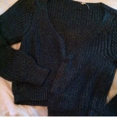 Free people cardigan - shiny grey This cropped cardigan is perfect for the fall for layering! It's marked a large but could really fit any size. Great condition! Free People Sweaters Cardigans
