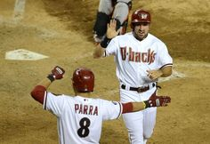 Adam Eaton #6 of the Arizona Diamondbacks is met at home plate by teammate Gerardo Parra #8 after scoring the go-ahead run in the seventh inning against the Baltimore Orioles at Chase Field on August 12, 2013 in Phoenix, Arizona. (Photo by Norm Hall/Getty Images)