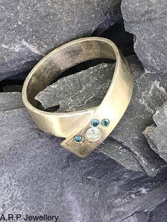 Sterling Silver Band with Three Blue Diamonds and One Clear by ARPJewellery on Etsy