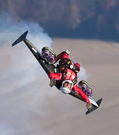 Swiss pilot Yves Rossy performs in his jet-fitted wing in Bercher ...