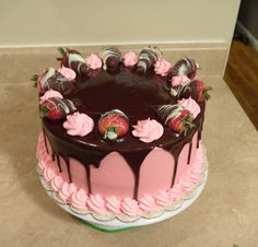 Strawberry Delight White Cake filled with strawberry mousse, iced in cream cheese buttercream with chocolate ganache to top it off